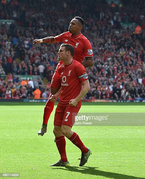 James Milner of Liverpool celebrates his goal with Nathaniel Clyne during the Barclays Premier League match between Liverpool and Aston Villa on...