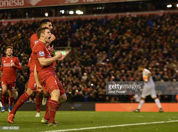James Milner of Liverpool celebrates his penalty goal during the Barclays Premier League match between Liverpool and Swansea City at Anfield on...