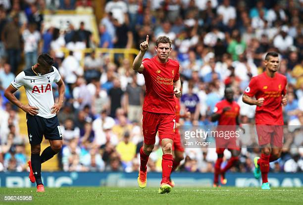 James Milner of Liverpool celebrates scoring his sides first goal during the Premier League match between Tottenham Hotspur and Liverpool at White...