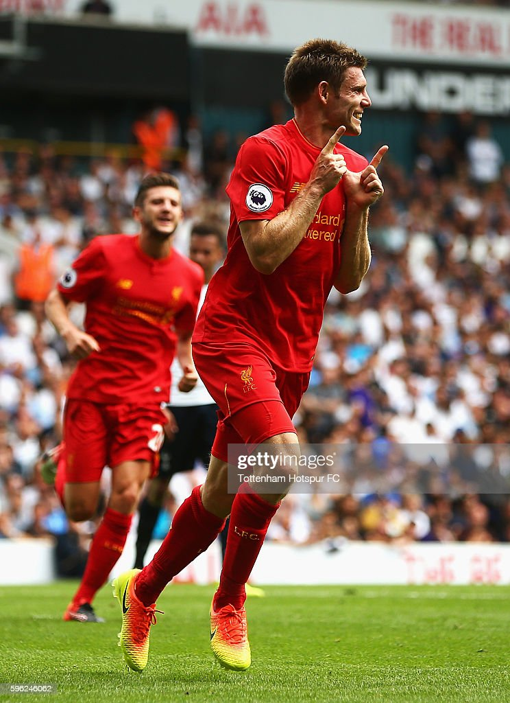 James Milner of Liverpool celebrates scoring his sides first goal during the Premier League match between Tottenham Hotspur and Liverpool at White Hart Lane on August 27, 2016 in London, England.