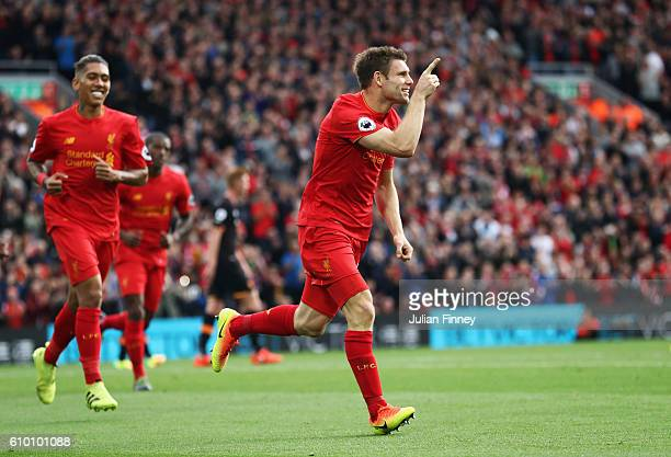 James Milner of Liverpool celebrates scoring his sides second goal during the Premier League match between Liverpool and Hull City at Anfield on...