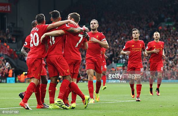James Milner of Liverpool celebrates scoring his sides second goal with team mates during the Premier League match between Liverpool and Hull City at...