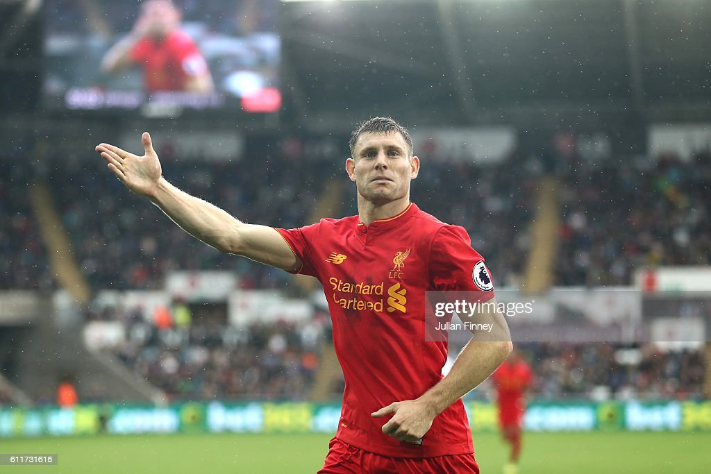 James Milner of Liverpool celebrates scoring his sides second goal during the Premier League match between Swansea City and Liverpool at Liberty Stadium on October 1, 2016 in Swansea, Wales.