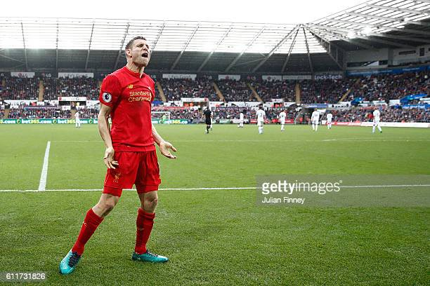 James Milner of Liverpool celebrates scoring his sides second goal during the Premier League match between Swansea City and Liverpool at Liberty...