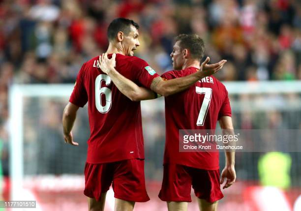 James Milner of Liverpool celebrates scoring his teams first goal during the Carabao Cup Third Round match between Mk Dons and Liverpool FC at...