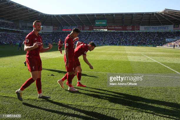 James Milner of Liverpool celebrates scoring their 2nd goal during the Premier League match between Cardiff City and Liverpool FC at Cardiff City...
