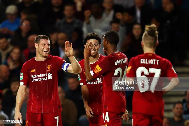 James Milner of Liverpool celebrates with his team mates after scoring his sides first goal during the Carabao Cup Third Round match between Milton...
