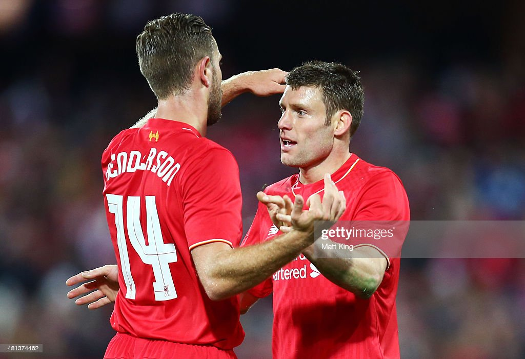 James Milner (R) of Liverpool celebrates with Jordan Henderson (L) after scoring the first goal during the international friendly match between Adelaide United and Liverpool FC at Adelaide Oval on July 20, 2015 in Adelaide, Australia.