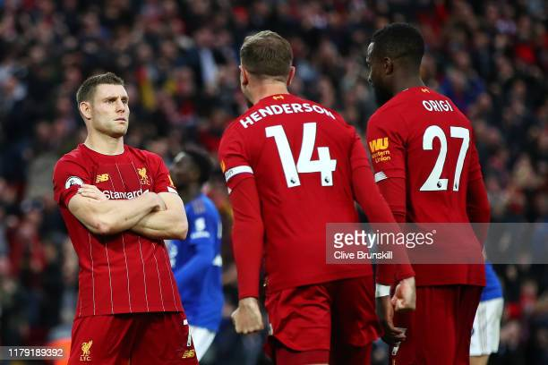 James Milner of Liverpool celebrates with Jordan Henderson of Liverpool and Divock Origi of Liverpool after he scores his sides second goal from the...