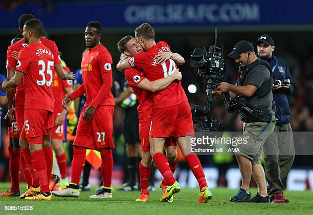 James Milner of Liverpool celebrates with Jordan Henderson of Liverpool during the Premier League match between Chelsea and Liverpool at Stamford...