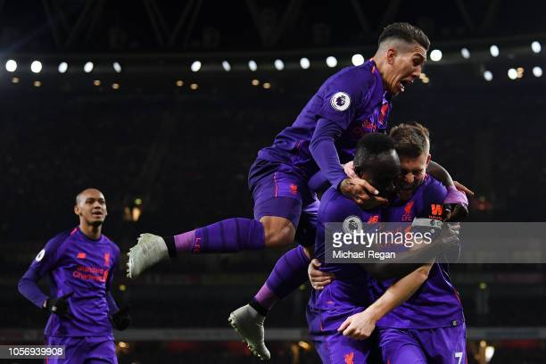 James Milner of Liverpool celebrates with Sadio Mane Andy Robertson Roberto Firmino and Fabinho of Liverpool after he scores his sides first goal...