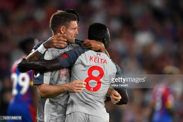 James Milner of Liverpool celebrates with teammates after he scores his sides first goal during the Premier League match between Crystal Palace and...