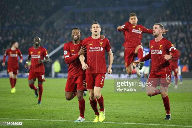 James Milner of Liverpool celebrates with teammates after scoring his team's second goal during the Premier League match between Leicester City and...