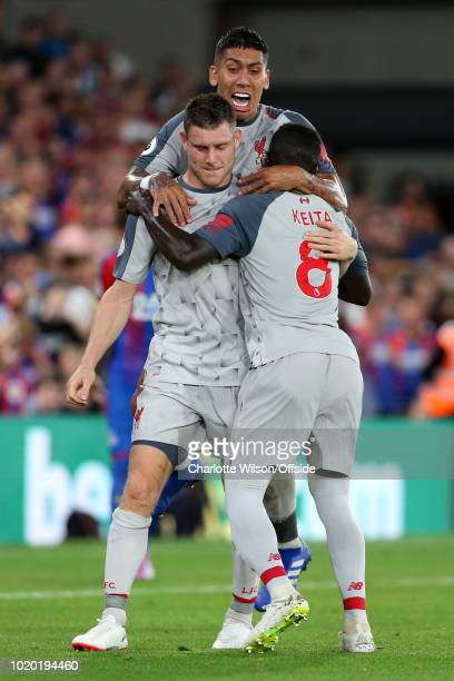 James Milner of Liverpool celebrates with teammates Roberto Firmino of Liverpool and Naby Keita of Liverpool after scoring their 1st goal during the...