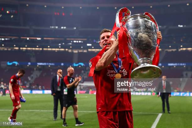 James Milner of Liverpool celebrates with the UEFA Champions League trophy during the UEFA Champions League Final between Tottenham Hotspur and...