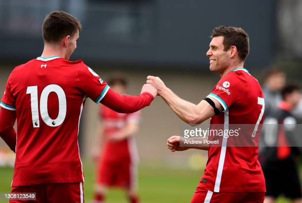 James Milner of Liverpool celebrating a goal scored by Ben Woodburn during a training session at AXA Training Centre on March 20, 2021 in Kirkby,...