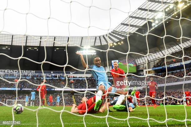 James Milner of Liverpool challenges Raheem Sterling of Manchester City in the penalty box during the Premier League match between Manchester City...