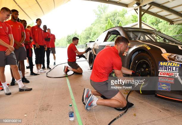 James Milner of Liverpool changing tyres during a tour of Roush Fenway Racing on July 21 2018 in Charlotte North Carolina