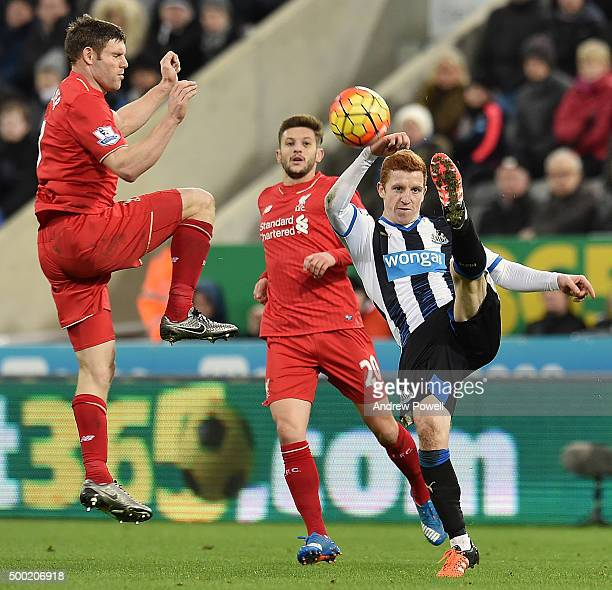 James Milner of Liverpool competes with Jack Colback of Newcastle United during the Barclays Premier League match between Newcastle United and...