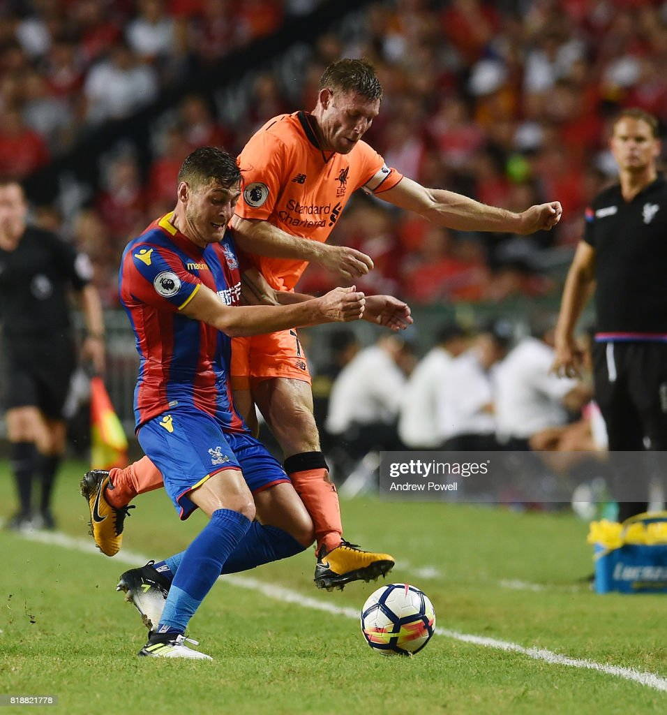 James Milner of Liverpool competes with Joel Ward of Crystal Palace during the Premier League Asia Trophy match between Liverpool FC and Crystal Palace on July 19, 2017 in Hong Kong Stadium, Hong Kong.