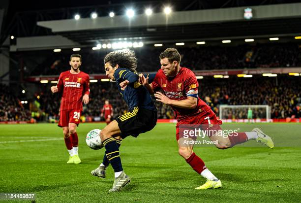 James Milner of Liverpool competes with Matteo Guendouzi of Arsenal during the Carabao Cup Round of 16 match between Liverpool FC and Arsenal FC at...