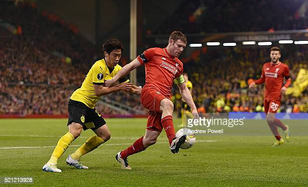 James Milner of Liverpool competes with Shinji Kagawa of Borussia Dortmund during the UEFA Europa League Quarter Final Second Leg match between...