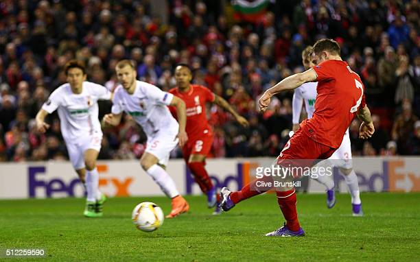 James Milner of Liverpool converts the penalty kick to score his team's first goal during the UEFA Europa League Round of 32 second leg match between...