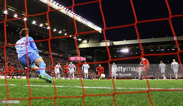 James Milner of Liverpool converts the penalty kick to score his team's first goal past Marwin Hitz of Augsburg during the UEFA Europa League Round...