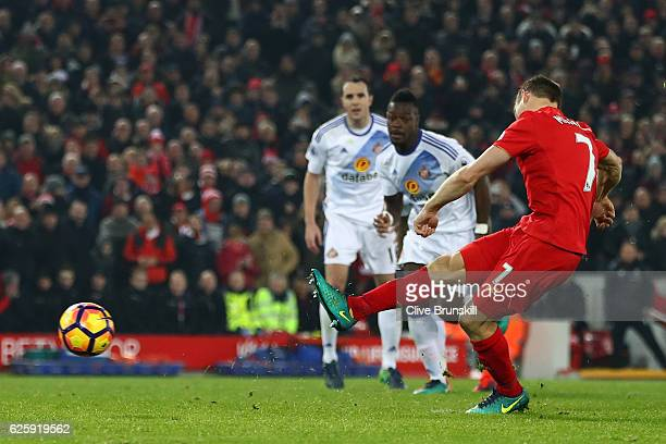 James Milner of Liverpool converts the penalty to score his team's second goal during the Premier League match between Liverpool and Sunderland at...