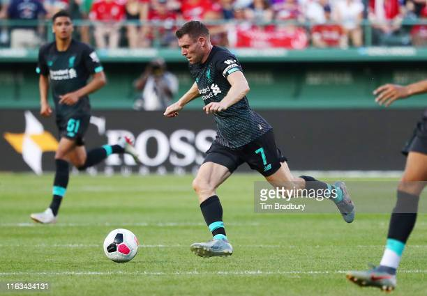 James Milner of Liverpool dribbles the ball during the second half against Sevilla during a pre-season friendly at Fenway Park on July 21, 2019 in...