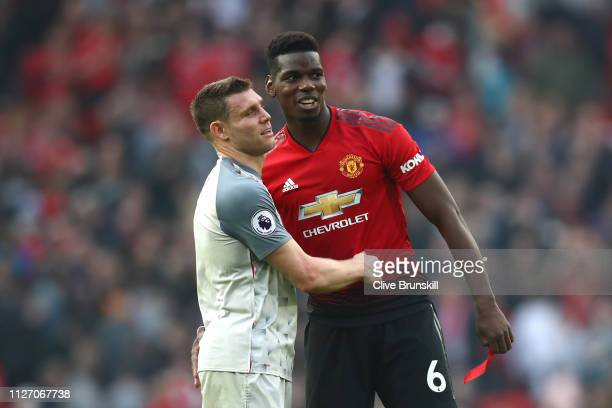 James Milner of Liverpool embraces Paul Pogba of Manchester United following the Premier League match between Manchester United and Liverpool FC at...