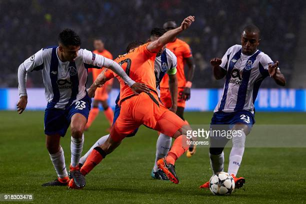 James Milner of Liverpool FC competes for the ball with Ricardo Pereira of FC Porto during the UEFA Champions League Round of 16 First Leg match...