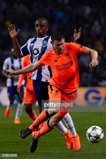 James Milner of Liverpool FC is challenged by Ricardo Pereira of FC Porto during the UEFA Champions League Round of 16 First Leg match between FC...