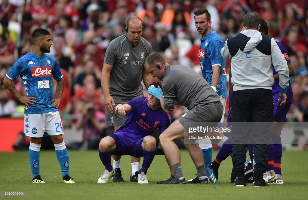 James Milner of Liverpool goes off following a head injury during the international friendly game between Liverpool and Napoli at Aviva Stadium on August 4, 2018 in Dublin, Ireland.
