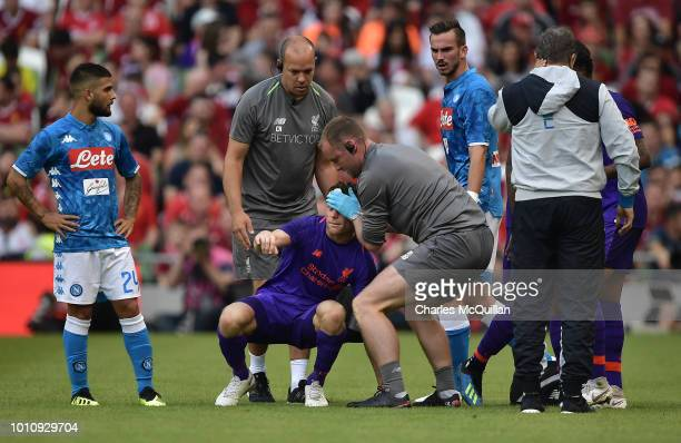 James Milner of Liverpool goes off following a head injury during the international friendly game between Liverpool and Napoli at Aviva Stadium on...