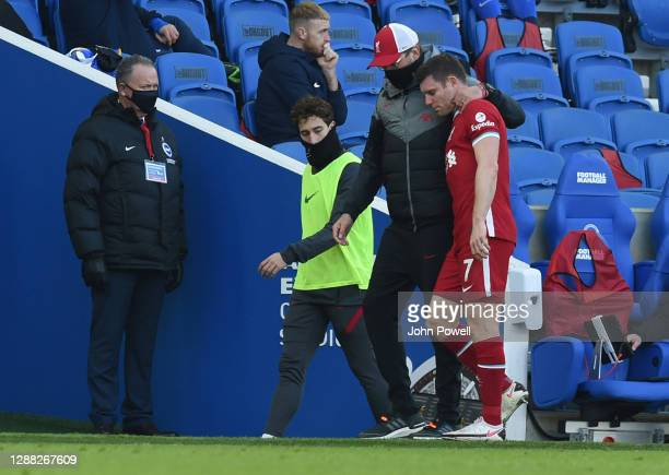 James Milner of Liverpool goes off injured during the Premier League match between Brighton & Hove Albion and Liverpool at American Express Community...