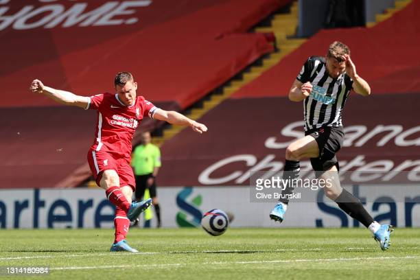 James Milner of Liverpool has a shot on goal during the Premier League match between Liverpool and Newcastle United at Anfield on April 24, 2021 in...