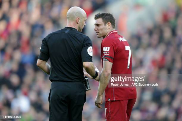 James Milner of Liverpool has a word with referee Anthony Taylor during the Premier League match between Liverpool FC and AFC Bournemouth at Anfield...