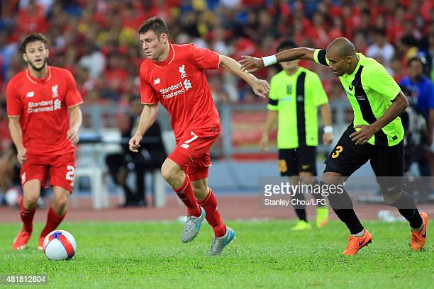 James Milner of Liverpool holds off Thiago of Malaysia XI during the international friendly match between Malaysia XI and Liverpool FC at Bukit Jalil...