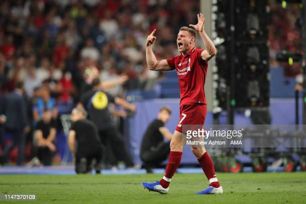 James Milner of Liverpool holds up 6 fingers after Liverpool win the champions league for the 6th time after the UEFA Champions League Final between...