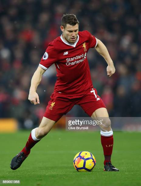 James Milner of Liverpool in action during the Premier League match between Liverpool and Everton at Anfield on December 10 2017 in Liverpool England