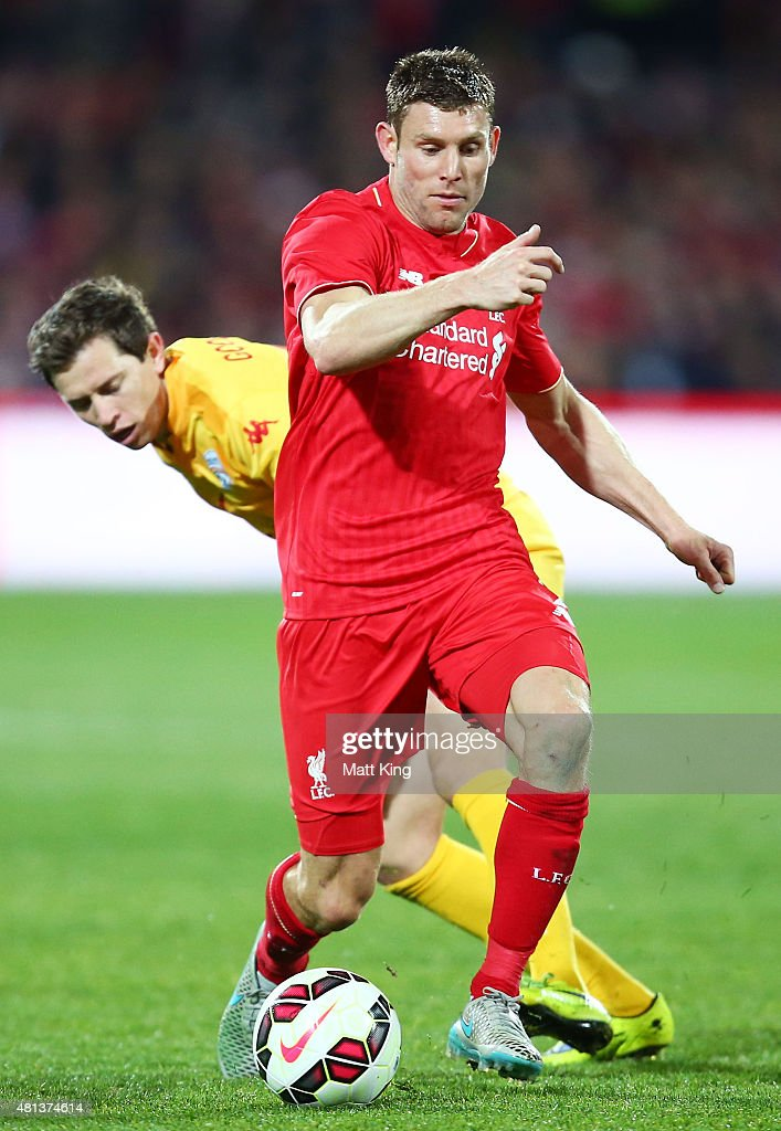 James Milner of Liverpool is challenged by Craig Goodwin of United during the international friendly match between Adelaide United and Liverpool FC at Adelaide Oval on July 20, 2015 in Adelaide, Australia.