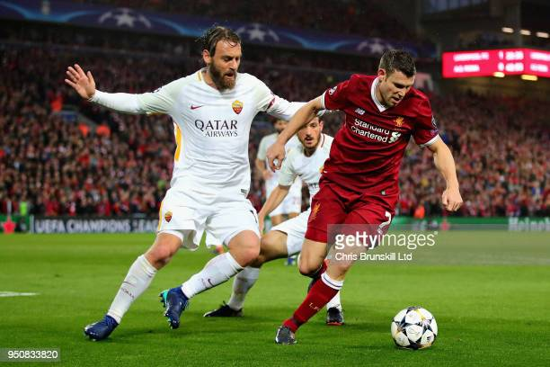 James Milner of Liverpool is challenged by Daniele De Rossi of AS Roma during the UEFA Champions League Semi Final First Leg match between Liverpool...