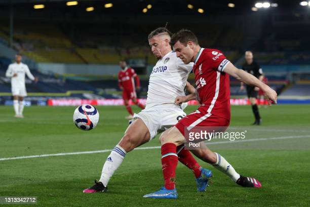 James Milner of Liverpool is challenged by Kalvin Phillips of Leeds United during the Premier League match between Leeds United and Liverpool at...