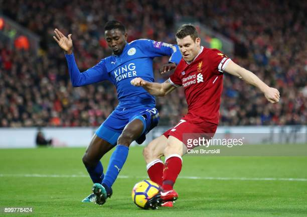 James Milner of Liverpool is closed down by Wilfred Ndidi of Leicester City during the Premier League match between Liverpool and Leicester City at...