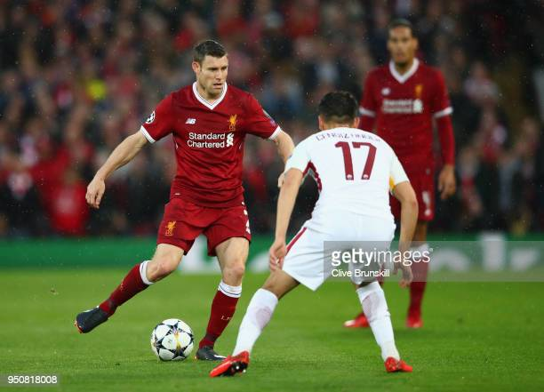 James Milner of Liverpool is faced by Cengiz Under of AS Roma during the UEFA Champions League Semi Final First Leg match between Liverpool and AS...