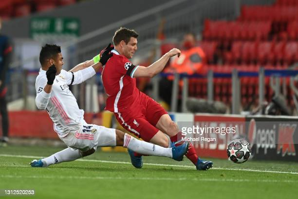 James Milner of Liverpool is fouled by Casemiro of Real Madrid during the UEFA Champions League Quarter Final Second Leg match between Liverpool FC...