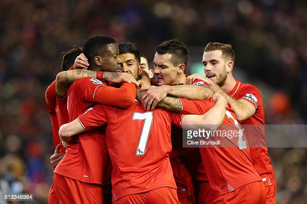James Milner of Liverpool is mobbed by teammates in celebration after scoring his sides second goal during the Barclays Premier League match between...