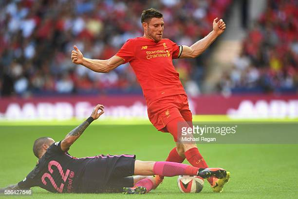 James Milner of Liverpool is tackled by Aleix Vidal of Barcelona during the International Champions Cup match between Liverpool and Barcelona at...
