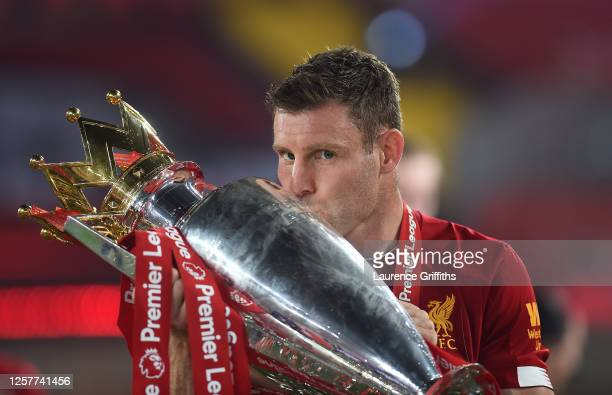 James Milner of Liverpool kisses the trophy to celebrate winning the League Title during the presentation ceremony of the Premier League match...